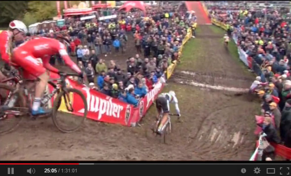 Kevin Pauwels crashes into the fencing at the 2013 Hamme-Zogge Superprestige cyclocross race.