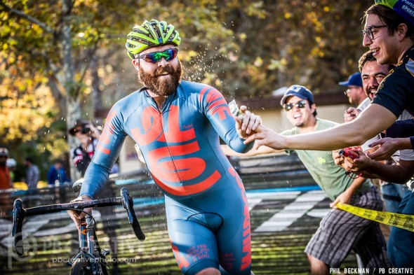Kyle Kelley picks up a buck and gets hosed with red wine. Wine? At a CX? Things are done a little differently in SoCal.