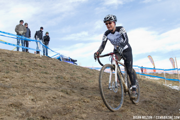 Catherine Nicoletti masters the off-camber in the women's 60-64 category. © Brian Nelson