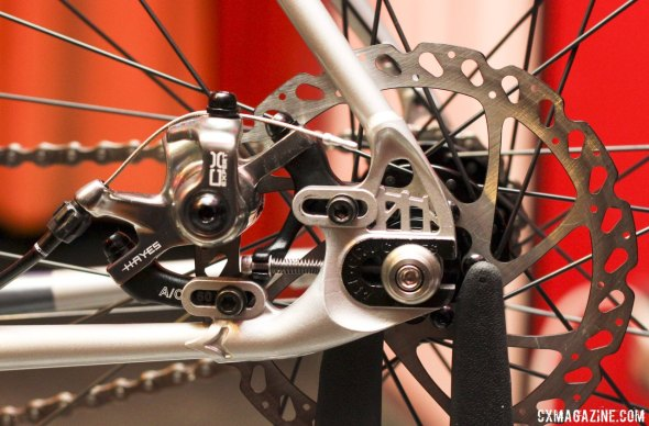 All-City Cycles' Nature Boy Disc has a cleverly designed, sliding post disc brake mount that also serves to adjust wheel placement and chain tension, via a 3mm Allen key. The Hennepin Bridge remains in the dropout. © Cyclocross Magazine