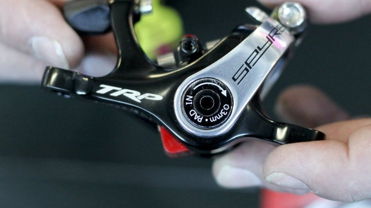 The TRP Brakes' post-recall dual piston Spyre now has two adjustable pads, and clearer adjustment instructions. No more confusing 5mm hex hole to hide the 3mm hex adjustment bolt. - Frost Bike 2014. © Cyclocross Magazine