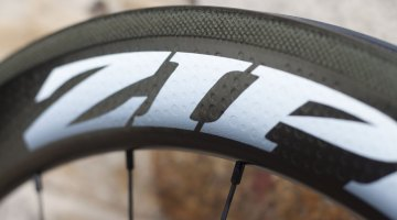 The ZIPP decal is impressed into the wheel, saving weight and matching the wheel's dimples