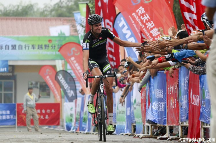 Ryan Trebon high-fives the crowd at the finish of the 2014 Qiansen Trophy Cyclocross Race © Cyclocross Magazine