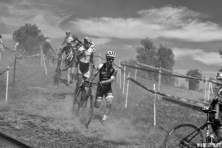 Bruce Weyman, Squareone, (shouldering his bike) and Matias Mendigochea, Helen's Cycling (running his bike in front of Bruce) negotiate the double run-up section in the 35+ As race.  Matias went on to take 2nd place. © Wade Hewitt