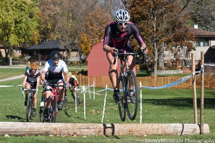 Russ Kuryk (Chicago, IL) leads Gerrit Sinclair (Bloomington, IL) over a log barrier. © SnowyMountain Photography