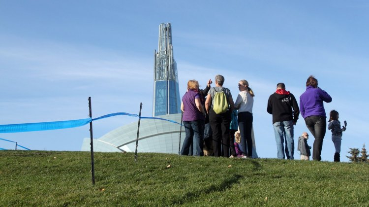 Spectators came to see the Kick Cancer Cyclocross activities, with Winnipeg's Museum of Human Rights soaring in the background. © Andrew Reimann