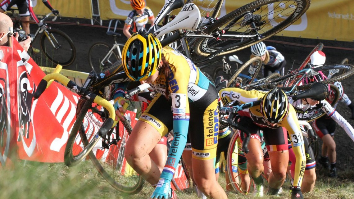 Nikki Harris keeps her head down and hand out in front of Meredith Miller early in the Superprestige of Spa-Francorchamps. © Bart Hazen