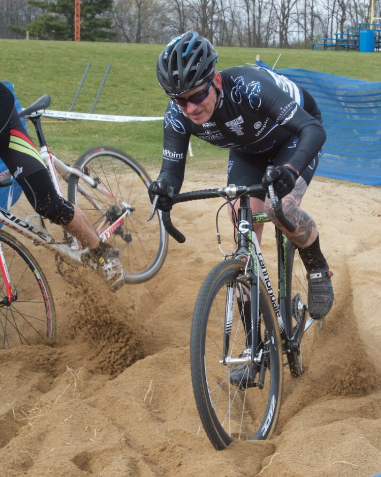 James Brady (Chicago, IL) carves sand while another Men's Cat 3 rider careens  toward the adjacent volleyball court.  © SnowyMountain Photography