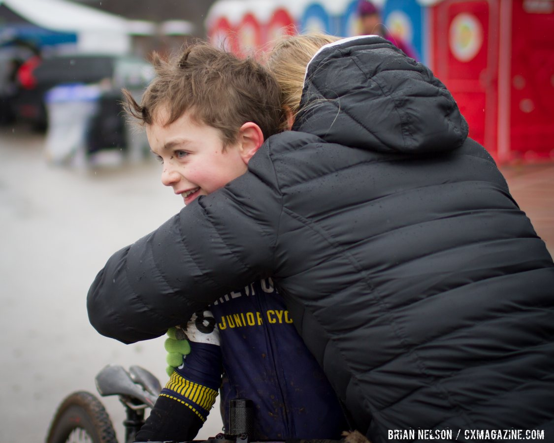 zachary-smith-pdx-devo-junor-cycling-team-gets-a-warm-embrace-after-the-9-10-race-brian-nelson