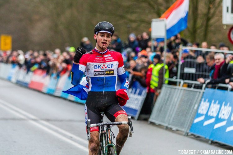 Van der Poel celebrates with the Dutch flag in hand in his home country at Hoogerheide. © Thomas van Bracht / Cyclocross Magazine