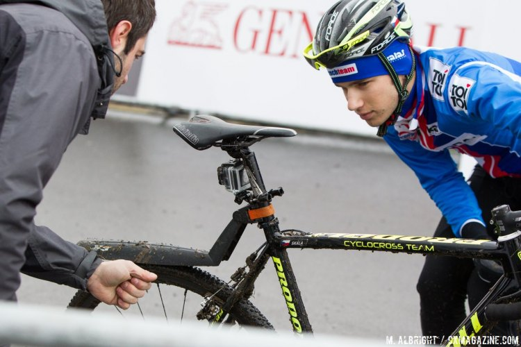 Installing a GoPro and fender, both items are only legal for pre-rides. © Mike Albright / Cyclocross Magazine