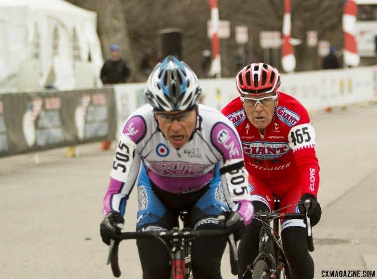 James Alan Coats staring down Sam Morse in the Masters 50-54 race. ©Cyclocross Magazine