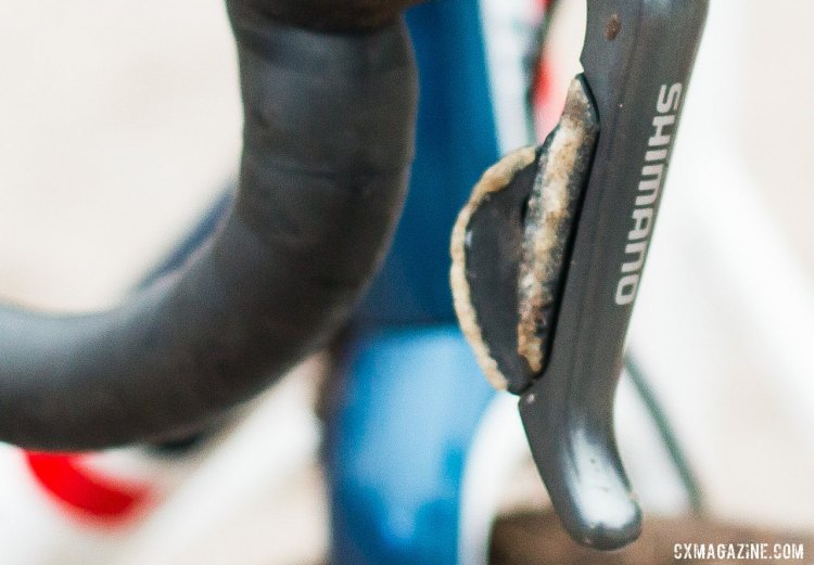 Close inspection of Compton's hydraulic R785 STI levers reveals a buildup of glue and grit along the right downshift button and along the back edge of the upshift paddle of her shifters. © Cyclocross Magazine