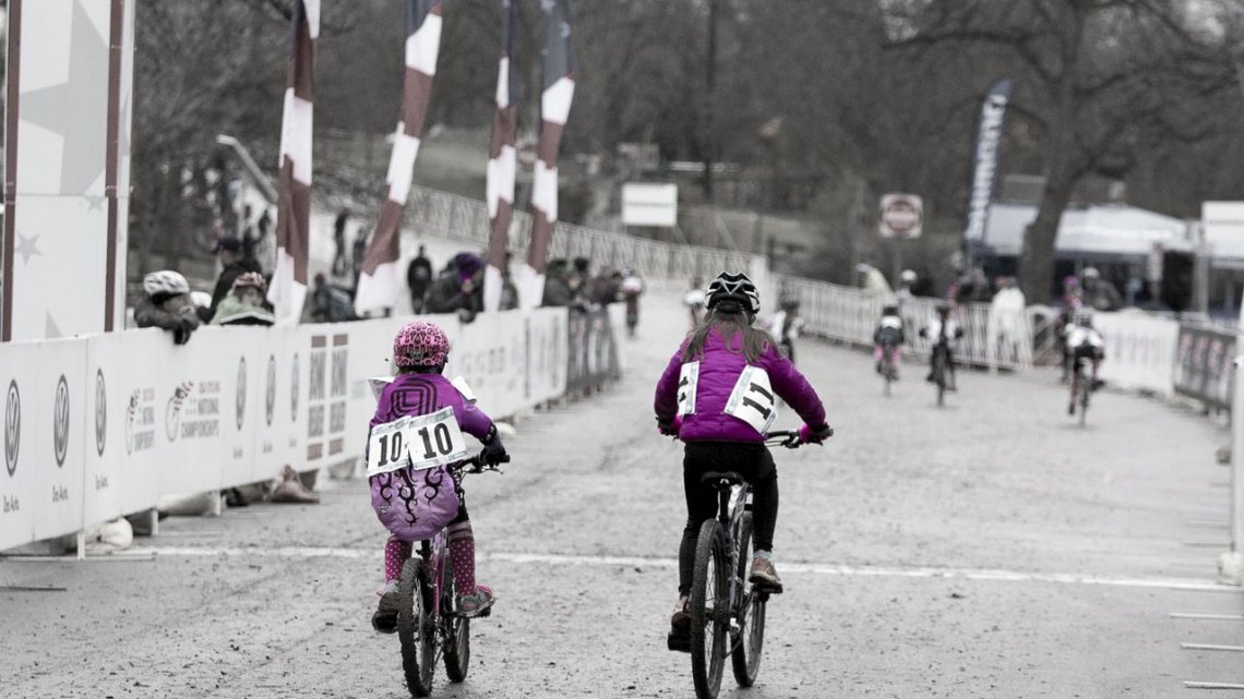 Gretchen Wayman and Mckenna Wilkins, both in Purple and from Texas, started the Junior 9-10 race together and tackled the tough course and conditions together. © Cyclocross Magazine