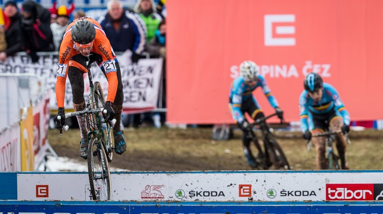 Van der Poel kept risking the barriers, although it took him three laps to get his hopping dialed. © Matthew Lasala / Cyclocross Magazine