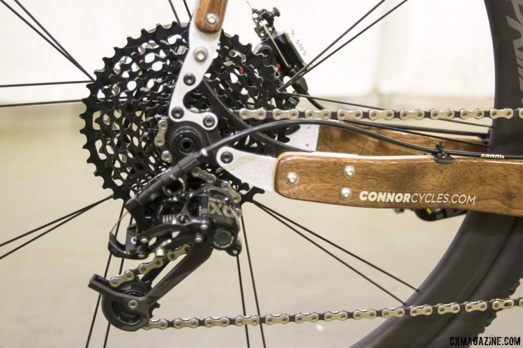 Chris Connor did some playing with SRAM components for this customer's bike, and manged to pair an X0 rear derailleur with an XD 10-42 11-speed cassette and Force 11-speed road shifter. NAHBS 2015. © Cyclocross Magazine