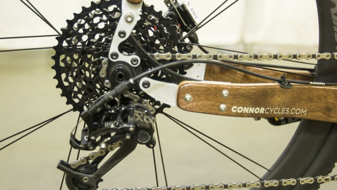 Chris Connor from Connor Wood Bicycles did some playing with SRAM components for this customer's bike, and manged to pair an X0 rear derailleur with an XD 10-42 11-speed cassette and Force 11-speed road shifter. NAHBS 2015. © Cyclocross Magazine