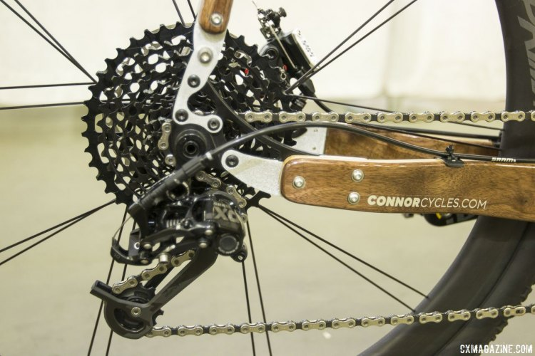 Chris Connor from Connor Wood Bicycles did some playing with SRAM components for this customer's bike, and managed to pair an X0 rear derailleur with an XD 10-42 11-speed cassette and Force 11-speed road shifter. NAHBS 2015. © Cyclocross Magazine