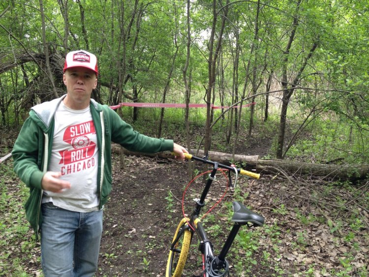 Steve Buchtel, Friends of Big Marsh program coordinator, says Big Marsh Bike Park is taking shape. The Downtown skyline can be seen in the distant background. [Photos by DNAinfo/Justin Breen]
