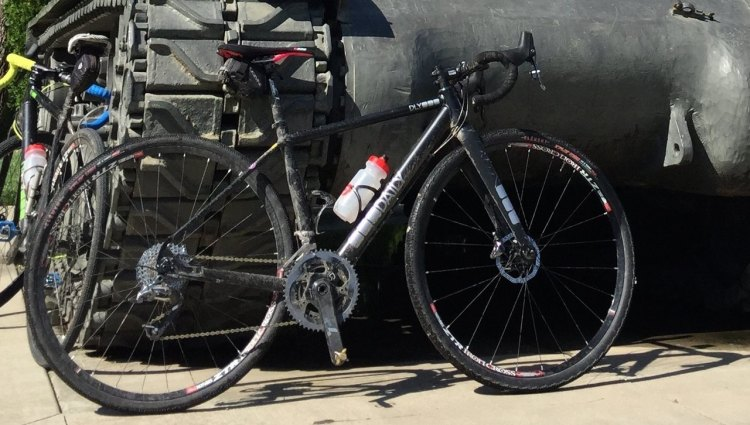 Amanda Nauman's Daily Bikes prototype cyclocross bike in front of a tank. © Amanda Nauman