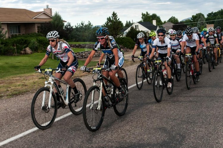 Mindy McCutcheon (Canyon Bicycles) and Joey Lythgoe (Kühl) lead the women's race through the flat roads after the start. Angie Kell (Church of the Big Ring) and Rhae Shaw (Liv) sit tucked in behind them. This is some of the last flat riding they will see at the Crusher.
