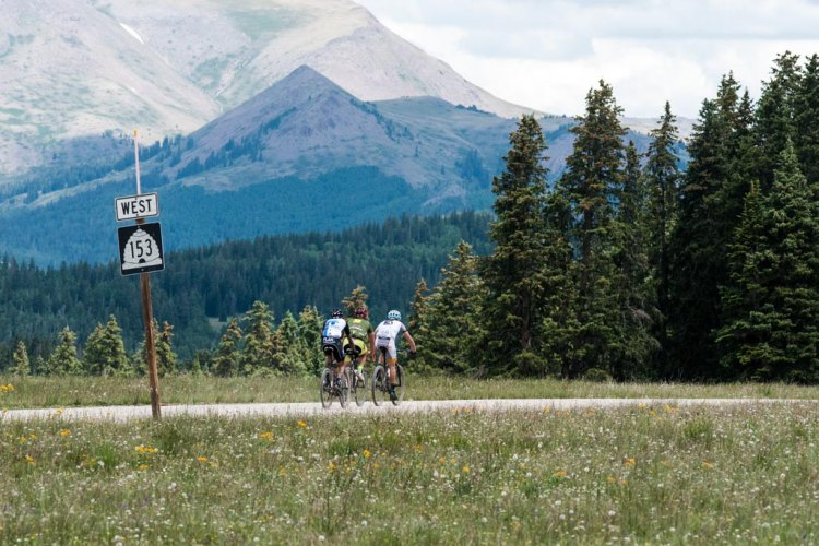 Go west, young man! A group of riders from the men's race pedals through a meadow at 10,700 feet on the way to the finish at Eagle Point ski resort.