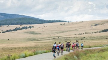 Here the group ramps up the lower reaches of 6,000 ft Mullen Pass under a roiling Montana sky. During the afternoon endurance rides, the group would often cross over the Continental Divide several times. © Tom Robertson