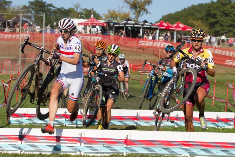 Helen Wyman, British National Cyclo-cross Champion, leading top racers through the barriers on her way to a win last year. Photo: Todd Prekaski