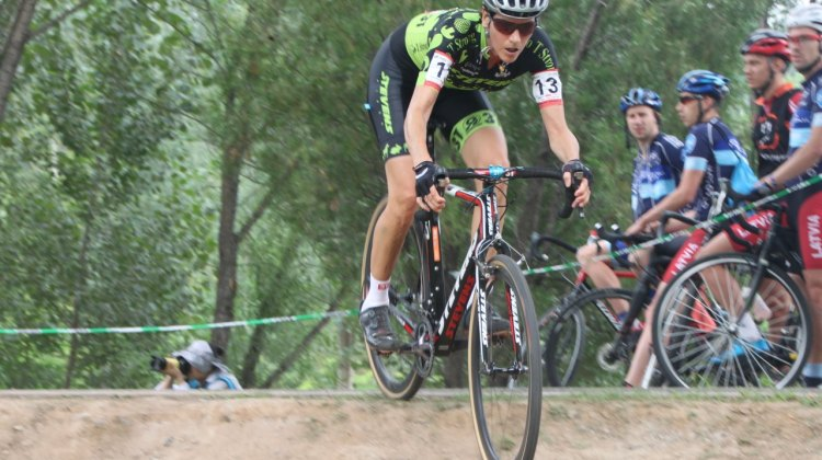 Vardaros prepares to descend on one of China's many course features. © A. Reimann / Cyclocross Magazine