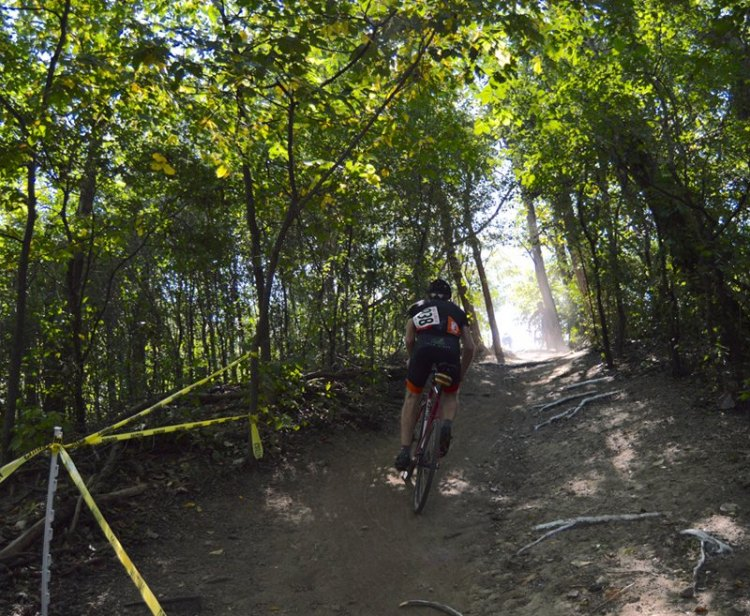 Michael Patton (Chicago, IL) climbs out of a wooded section during the Single Speed race.