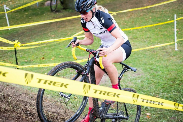 Abby Strigel (Bontrager) rides up the steep hill on her way to winning the elite women's race at the Sun Prairie Cup. Photo by B.D. Andrews