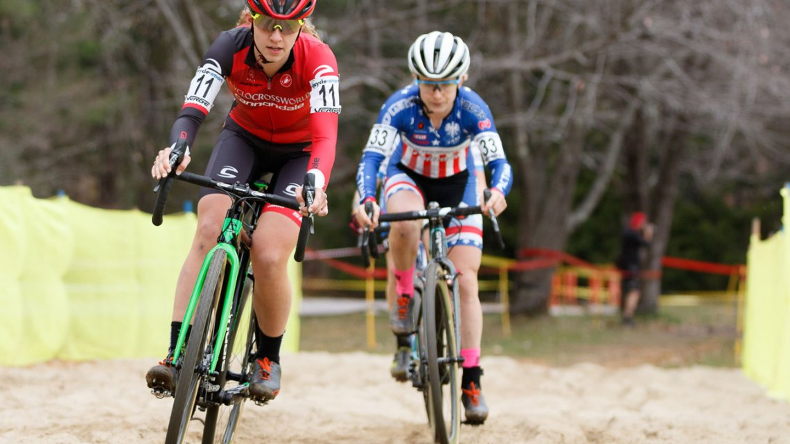 Emma White leads Ellen Noble through the sandpit. Photo by Todd Prekaski