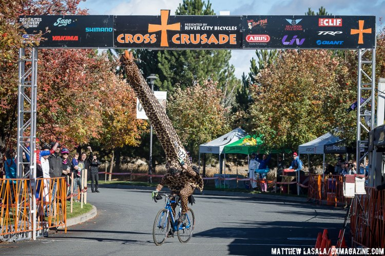 Best costume of the day was a HUGE giraffe that almost didn't make it under the finish banner. © Matthew Lasala