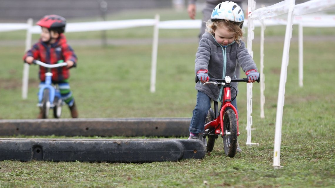 Racing is finding the fastest route between the tape, some say. Kid Cross Race, 2016 Cyclocross National Championships. © Cyclocross Magazine