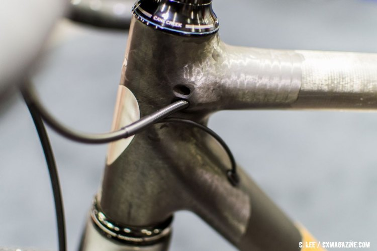 The extra hole is plumbed for a front derailleur shift cable. NAHBS 2016. © Clifford Lee / Cyclocross Magazine
