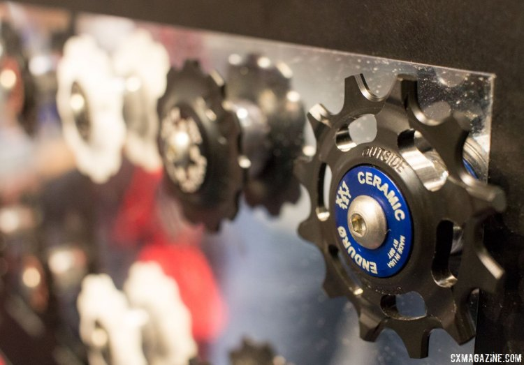 Enduro's wide-narrow pulleys are aimed as an upgrade for SRAM 1x derailleur users. The company maintains there are two gains: 1) from the reduced friction and durability of the delrin material; and 2) the reduced friction and life of their bearings. NAHBS 2016. © Cyclocross Magazine