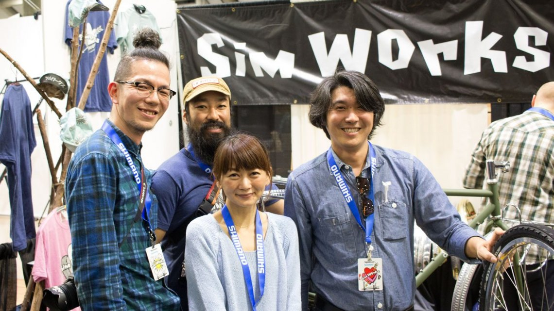 Shinya Tanaka (right) has built a little empire with his Sim Works and Circles brands in Japan, and now the company imports into the States. Tanaka has twenty employees, and brought twelve of them to the States for this trip. His businesses include a bike shop, a paint shop, component brand, an importer (including bringing Cyclocross Magazine into Japan), and a restaurant. Now he's also an exporter. © Cyclocross Magazine