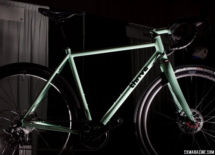The mint or celeste green brazed Thrive Cycles' steel cyclocross/gravel bike almost glows and stands out in the crowded show. NAHBS 2016. © Cyclocross Magazine