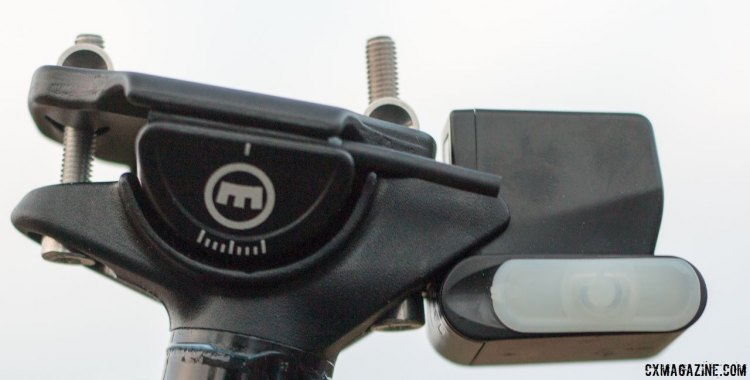 Magura's new Vyron wireless dropper post has a secure two-bolt saddle clamp and an manual on/off switch under the white cover that enables a handful of manual actuations should the battery need a charge. Magura Ride Camp 2016. © Cyclocross Magazine