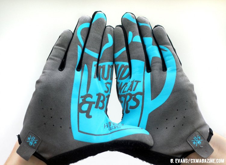 "All of the Handup gloves feature a design on the palms that take shape when the hands are held side by side. While not particularly easy to read at a glance, the messages–in this case ""Mud Sweat and Beers""–seem fitting to throw up at your local races. © Greg Evans / Cyclocross Magazine"