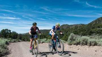 Mindy McCutcheon, left and Robin Farina, right rode side by side for most of the day neither yeilding until the slopes of Col D Crush where McCutheon soloed away for the win. Here the two racers are on Doc Springs Road (also known as the Sarlacc Pit). 2016 Tushar Crusher. Photo courtesy Christopher See