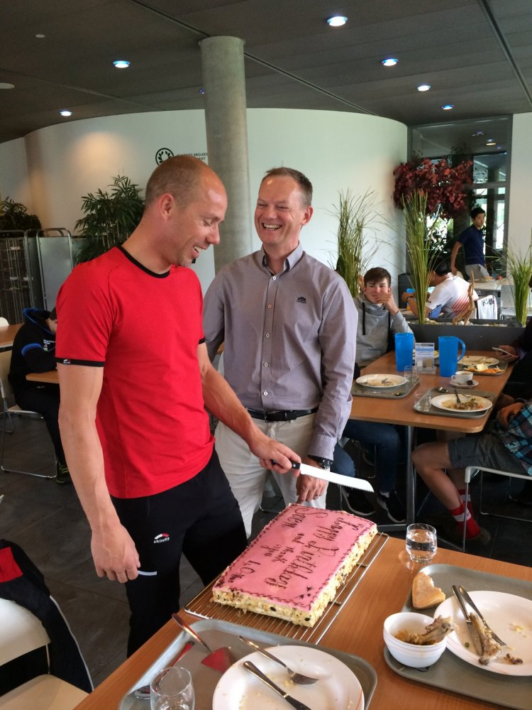 Sven cutting birthday cake with UCI's Peter Van den Abeele. UCI CX Training Camp 5.0. Photo courtesy Geoff Proctor.