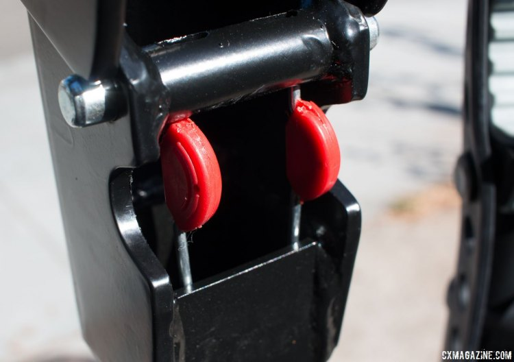 You fold the carry arm up and down using these two red levers. Allen Sports S535 Premier 3-bike hitch rack. © Cyclocross Magazine