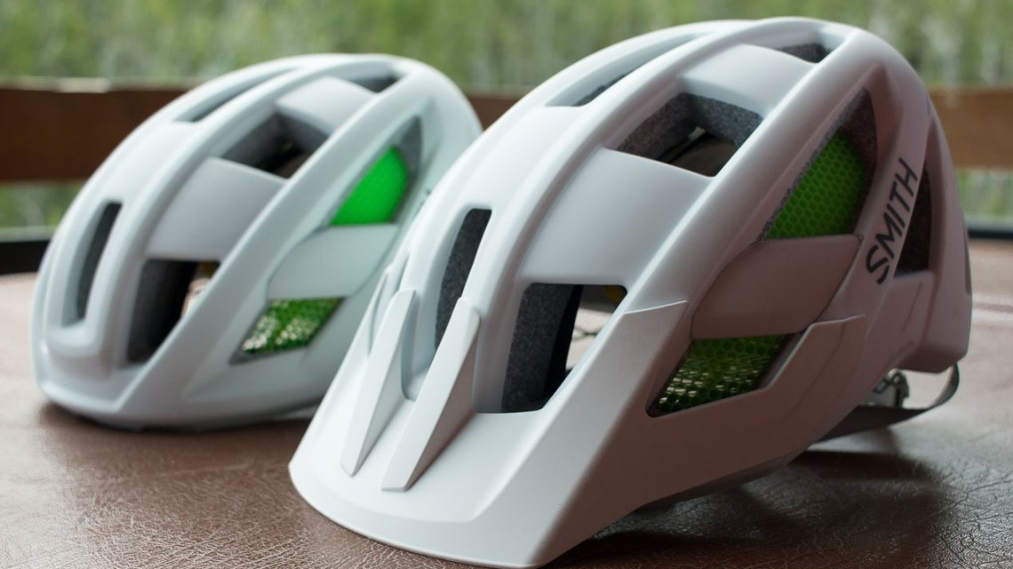 Smith's new Route (road, left) and Rover (mtb, right) helmets use different molds but look similar. The Rover has more coverage out back, and comes with a removeable visor. Press Camp 2016. © Cyclocross Magazine