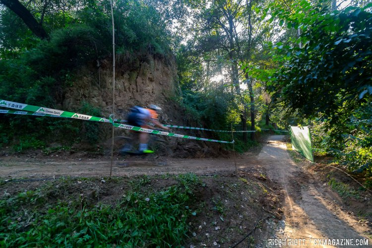 A couple of fast descents keep the pace high as the course returns back along the river banks in Yanqing @ R. Riott / Cyclocross Magazine