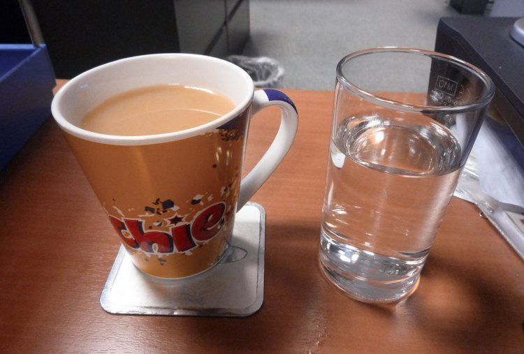 Drink the water before the coffee to ensure proper hydration, especially after a night of sleep with the heater on. Training Tuesday: Focusing on Rest and Recovery. photo: Ambernectar 13