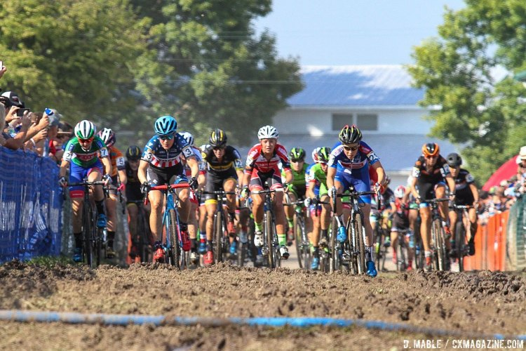 The women exit the pavement onto the mud. 2016 Jingle Cross World Cup, Elite Women. © D. Mable / Cyclocross Magazine