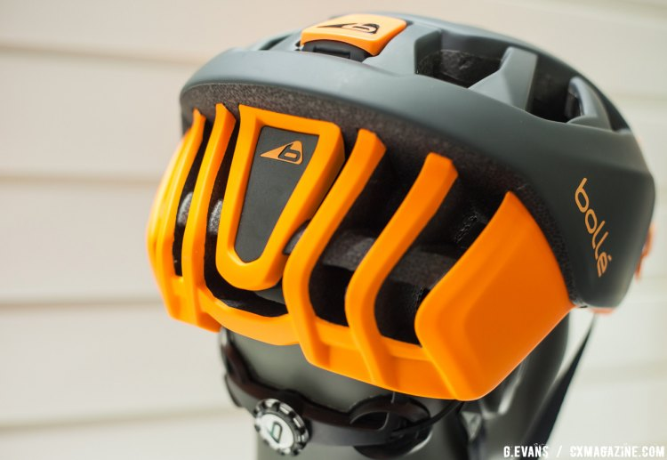 The helmet is offered in numerous colorways, including this black and orange finish shown here. The triangular panel on the back of the helmet pops out to make way for a rear light. © Cyclocross Magazine