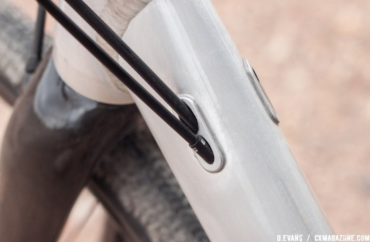 Internal routing through the downtube keeps things clean up front, and a modular cable stop on the drive side offers accommodations for a front derailleur. © Cyclocross Magazine