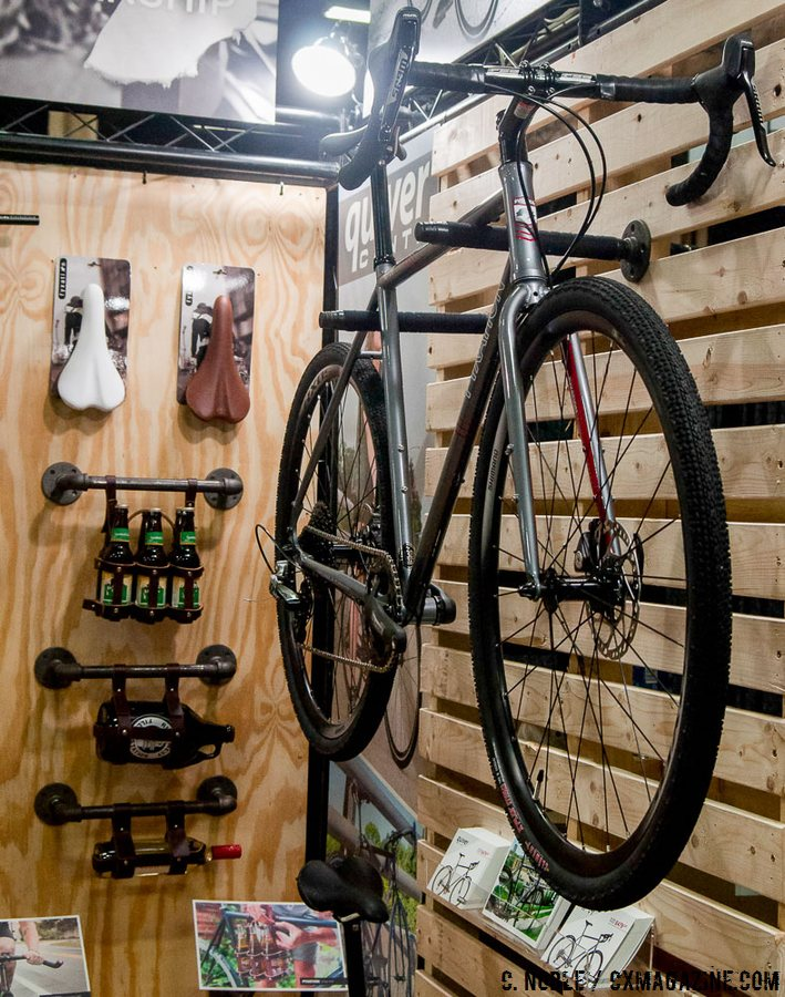 The Fyxation Quiver disc cyclocross bike caught our eye, but so did those handlebar beverage holders seen in the background. Hydration is important. Interbike 2016 © C. Noble / Cyclocross Magazine